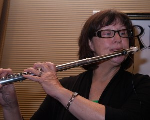 Busker Bobbie plays flute at Solivita